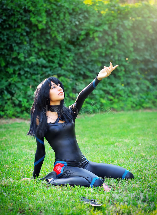 Young girl kneels and stretches out his hand to the sky. Original cosplay character stock images