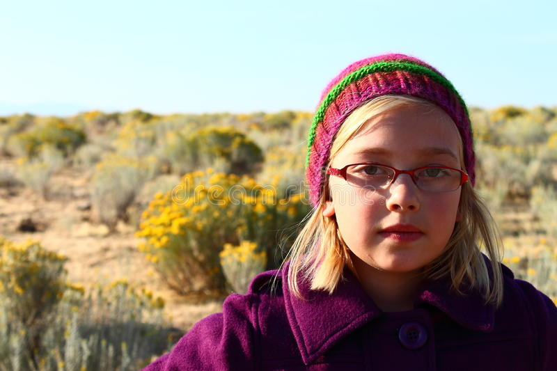 Young girl in knitted hat stock image