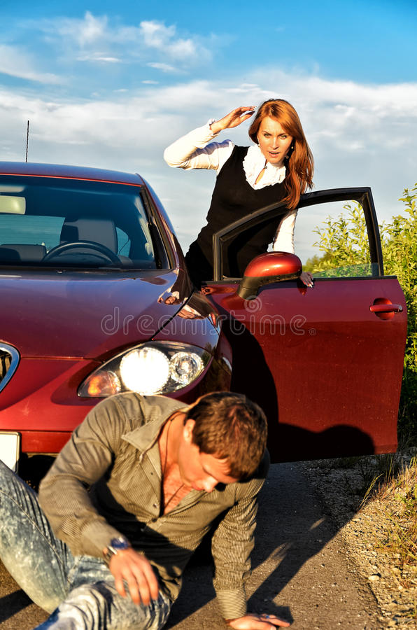 Young girl knocked down a man stock photography