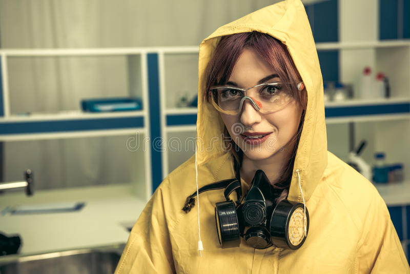 Young girl laboratory technician in personal protective equipment royalty free stock photos