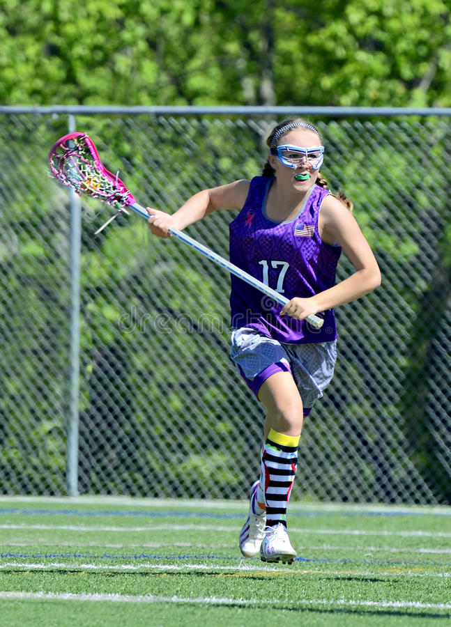 Young Girl Lacrosse Player royalty free stock photography