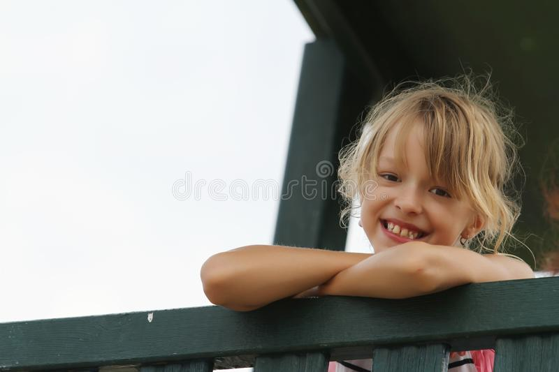 Young girl laughs and looks royalty free stock images
