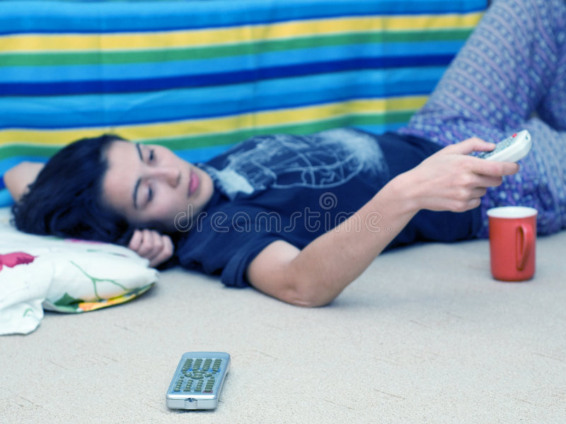 Download Young Girl Laying On Floor Using Remote Stock Photo - Image: 1738642