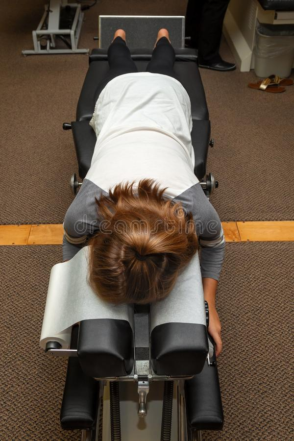 Young Girl Lays Face Down on a Chiropractic Adjustment Table royalty free stock photos