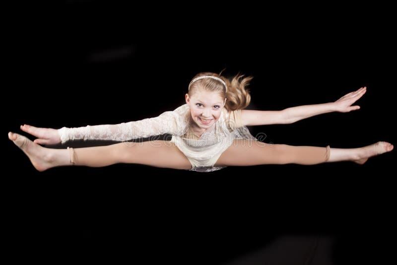 Young girl leap stock photos