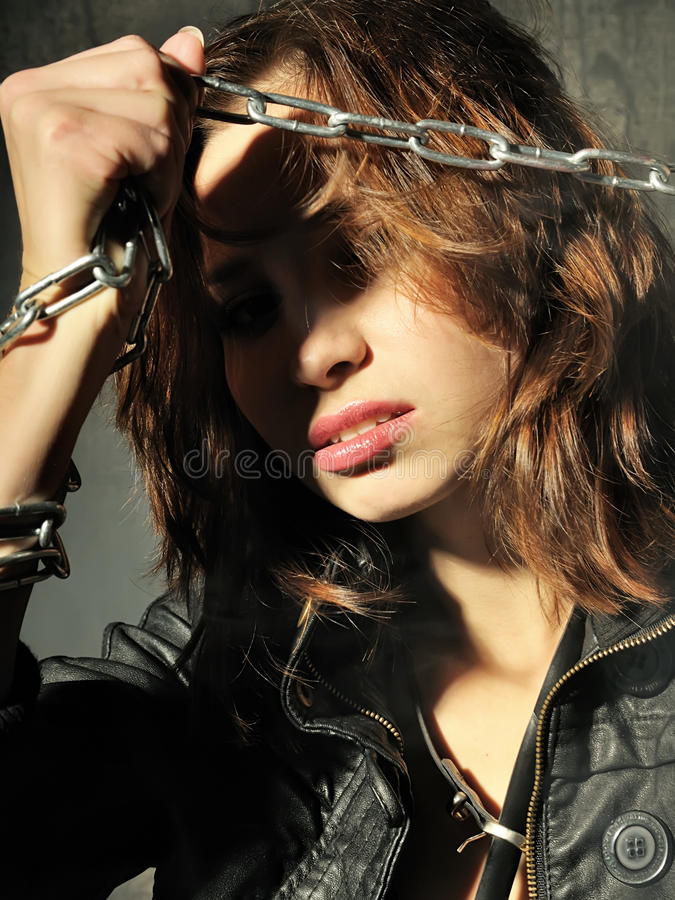 Young Girl In Leather Jacket With Chain Stock Image