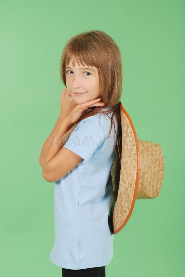 Girl holding a straw hat in hand stock image
