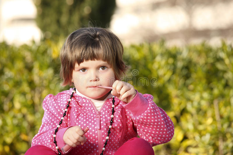 Young Girl And A Lip Gloss Royalty Free Stock Photo
