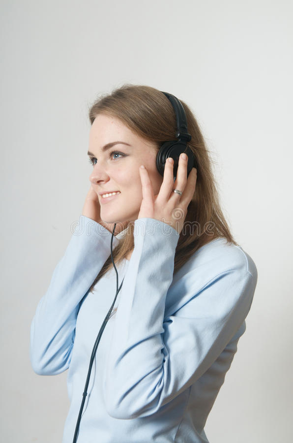 Young girl listen to music on headphone royalty free stock photography