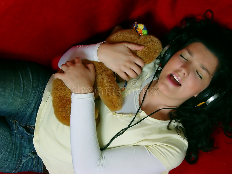 Young girl listening music royalty free stock image