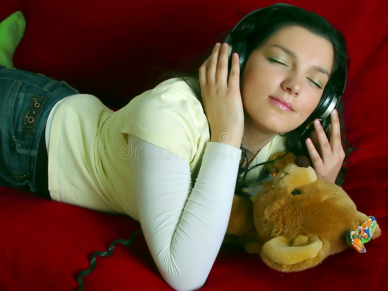 Download Young girl listening music stock photo. Image of female - 1811670
