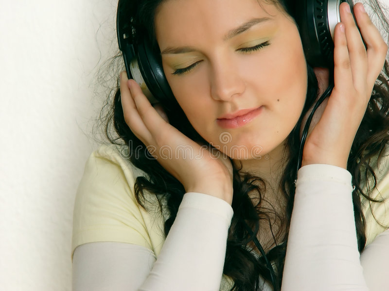Young girl listening music stock image