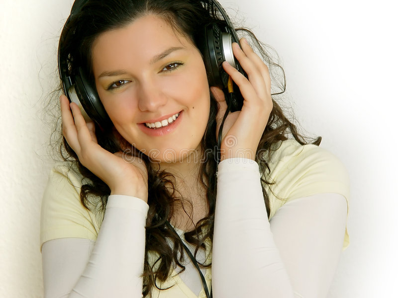 Young girl listening music stock photos