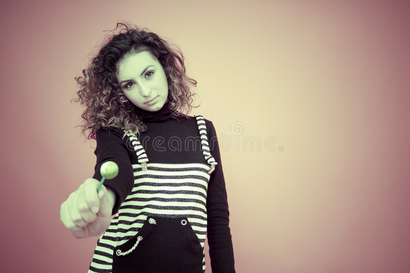 Young Girl with a Lollipop stock images