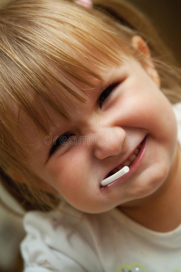 Download Young girl with lollipop stock image. Image of female - 34601963