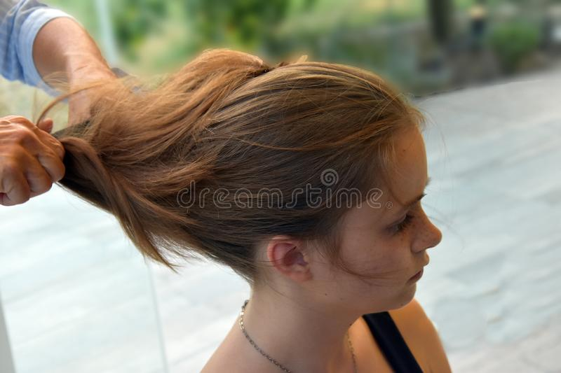 Teenage girl gets a new hairstyle stock image