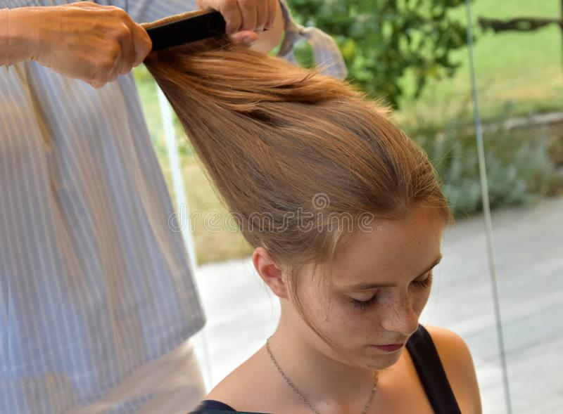 Teenage girl gets a new hairstyle royalty free stock image