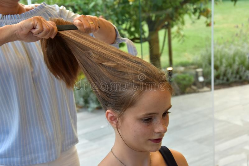 Teenage girl gets a new hairstyle stock photography