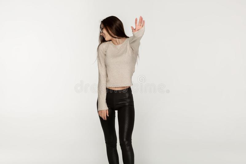 Young girl with long brunette girl in black leggings royalty free stock photography