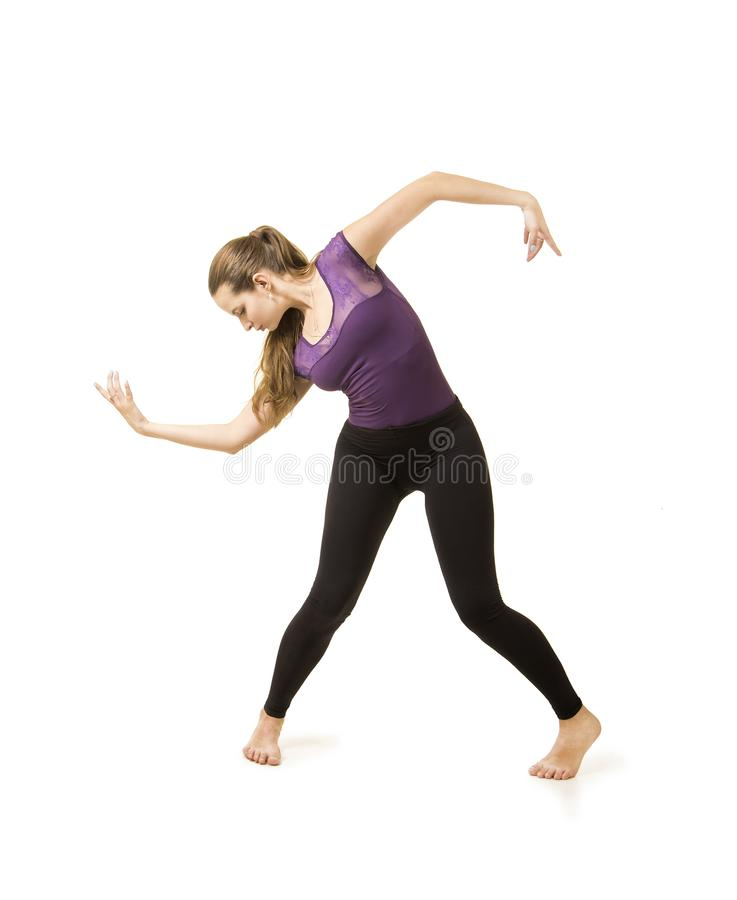 Young girl with long hair dancing modern ballet. royalty free stock images