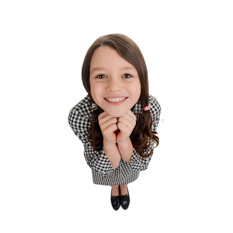 Young girl looking with admiration. Friendly smile and delighted mood. Cute wide angle portrait stock photos