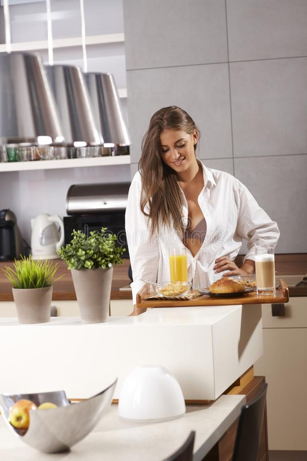 Young girl looking at breakfast tray stock photo