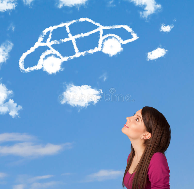 Young girl looking at car cloud on a blue sky. Casual young girl looking at car cloud on a blue sky stock image