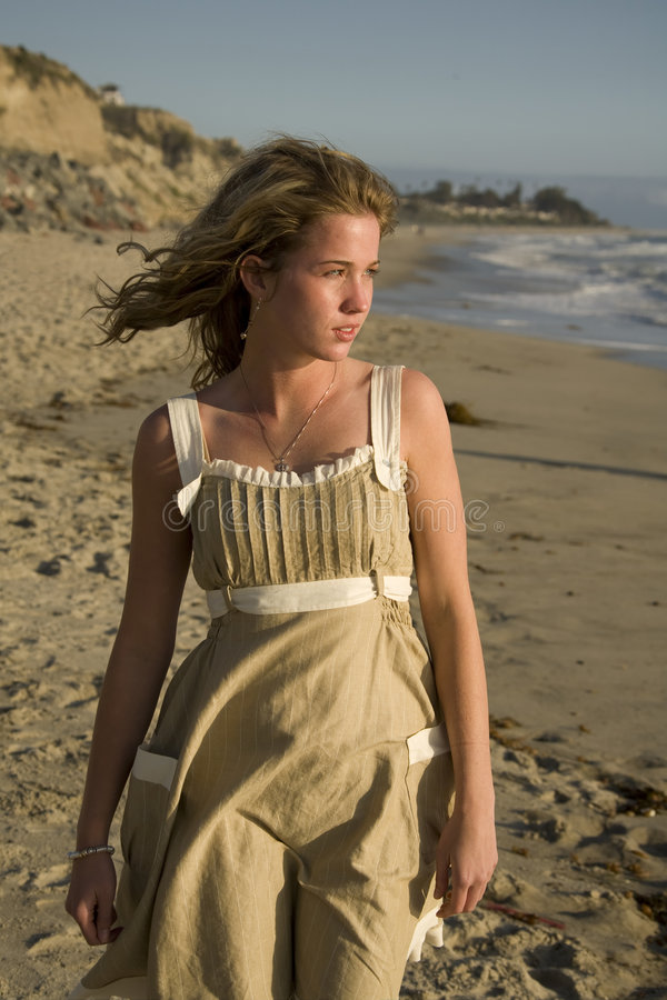 Young Girl looking at the Ocean. Beautiful young Girl walking and looking at the Ocean royalty free stock photography