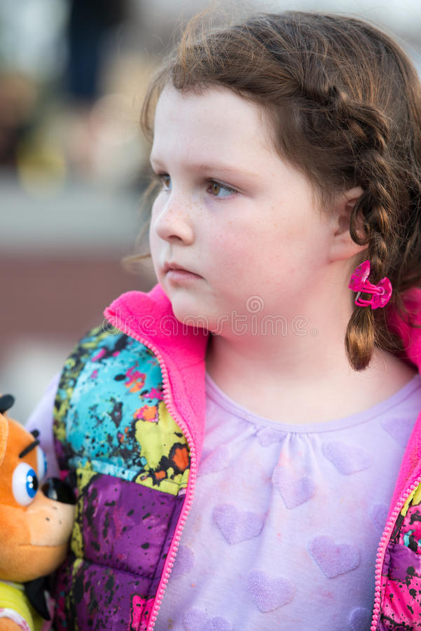 Young girl looking off into the distance. A Young girl looking off into the distance royalty free stock photos