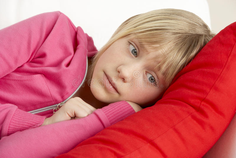 Young Girl Looking Sad On Sofa