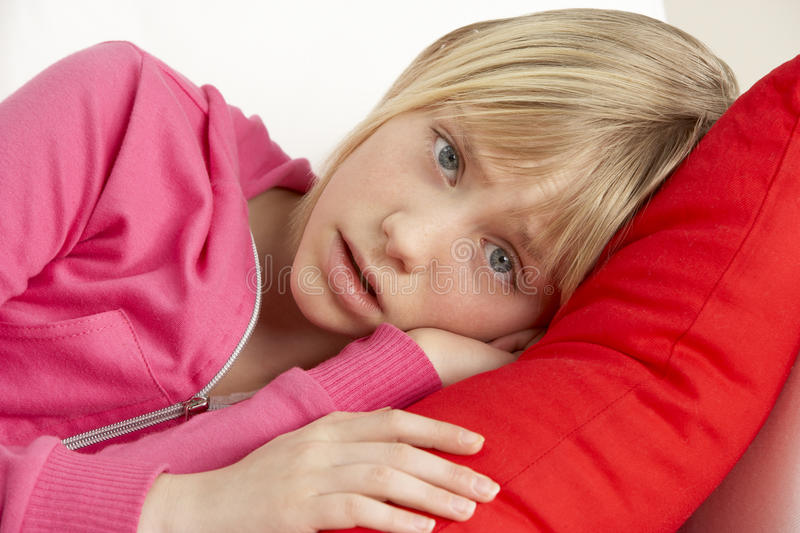 Download Young Girl Looking Sad On Sofa Stock Photo - Image: 10003712