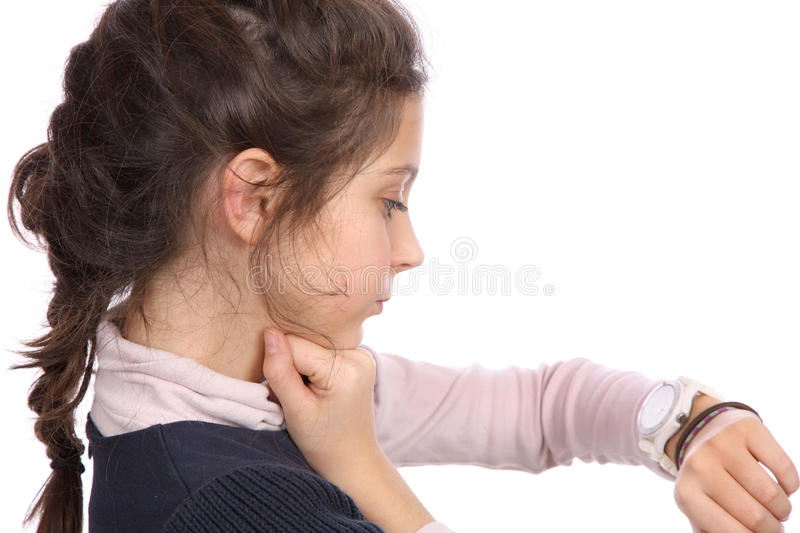 Young girl looking at watch royalty free stock photo