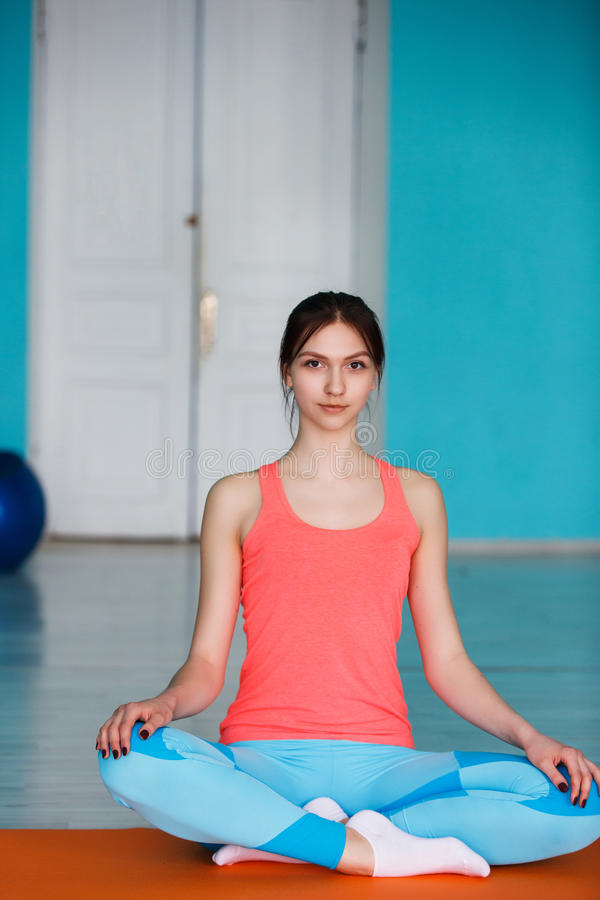 Young girl in lotus pose royalty free stock photos