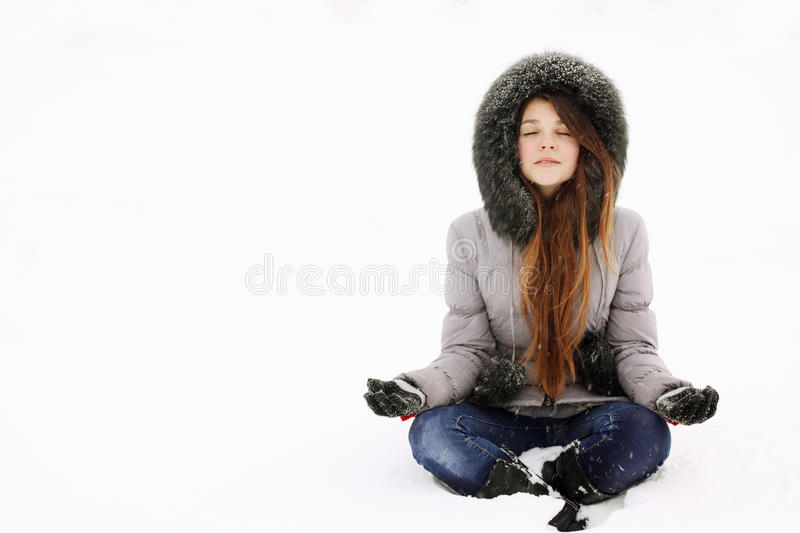Young girl in lotus pose stock photos