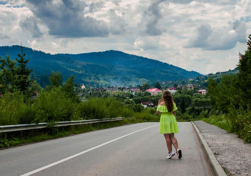 A young girl loves to travel and conquer the peaks of the mountains. She is happy royalty free stock image