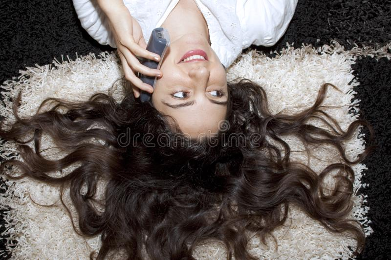 Download Young Girl Lying On The Carpet With Telephone Stock Photo - Image of relax, communicate: 10132536