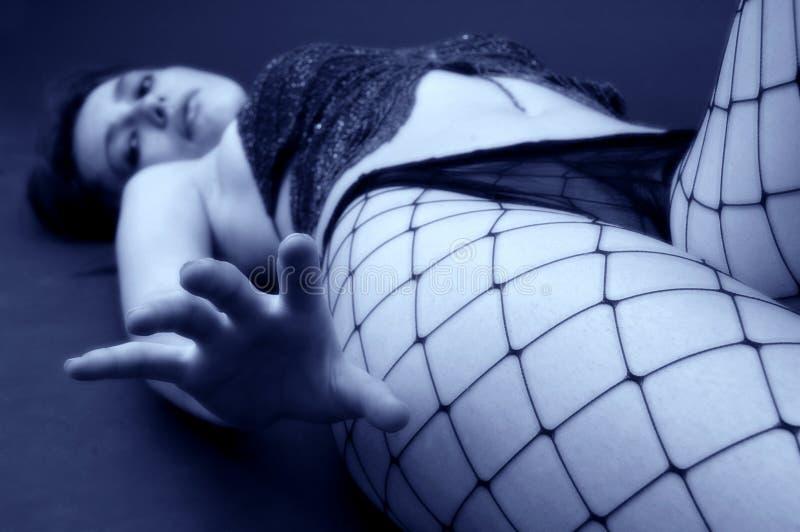 Young Girl Lying on Floor royalty free stock photos