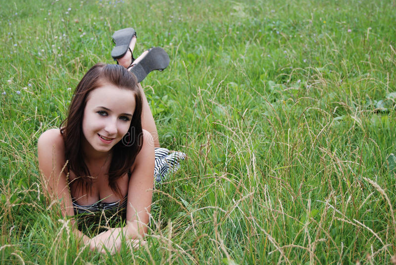 Young Girl Lying On The Grass Royalty Free Stock Images