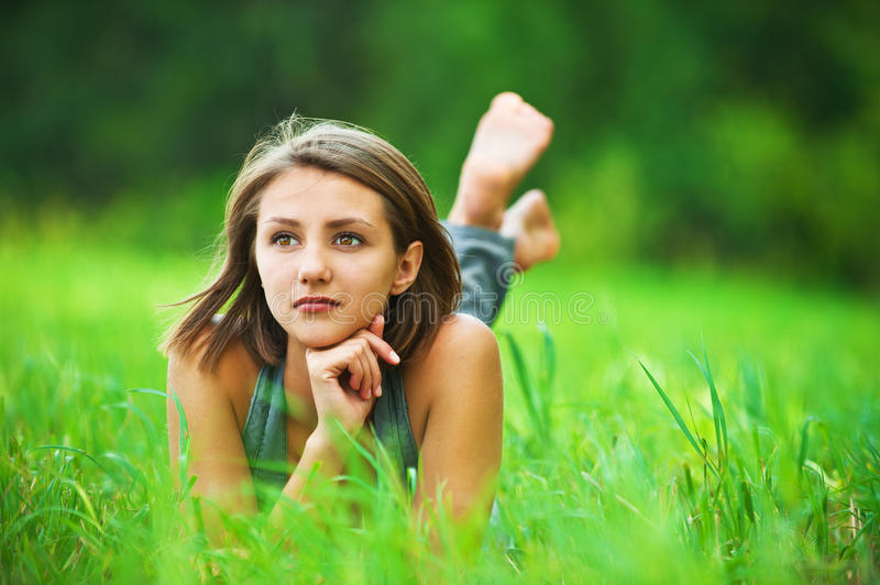 Download Young Girl Lying On Grass Dreaming Stock Image - Image: 22447439