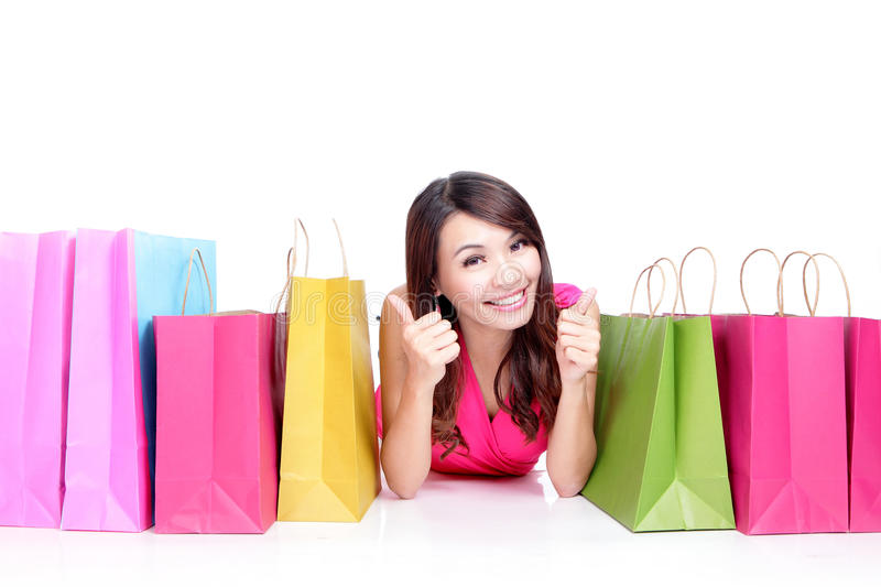 Young girl lying with shopping bags stock images