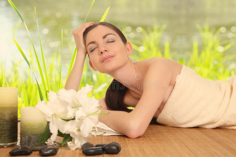 Young girl lying in a spa stock photos