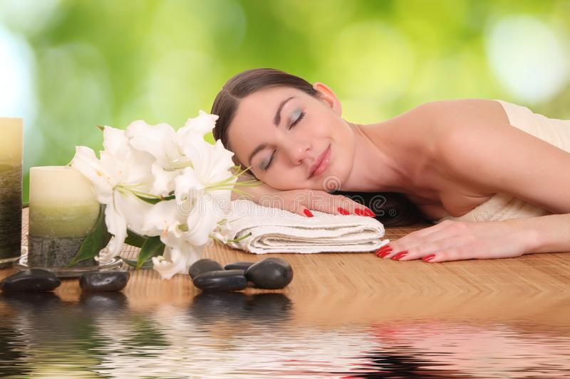Young girl lying in a spa royalty free stock image