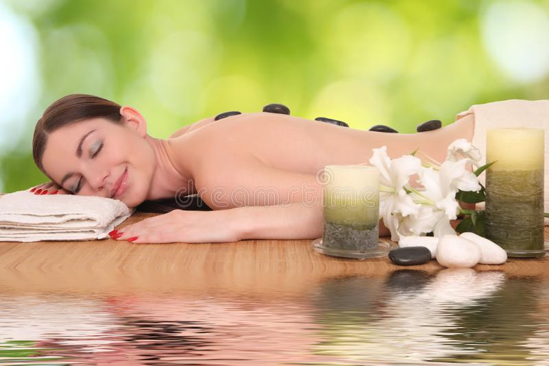 Young girl lying in a spa royalty free stock photo