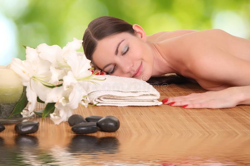 Young girl lying in a spa stock images