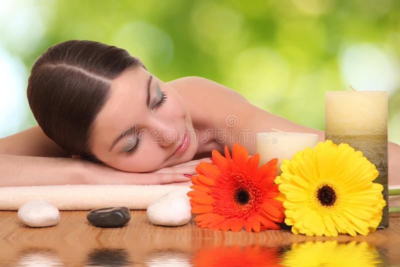 Young girl lying in a spa stock photography