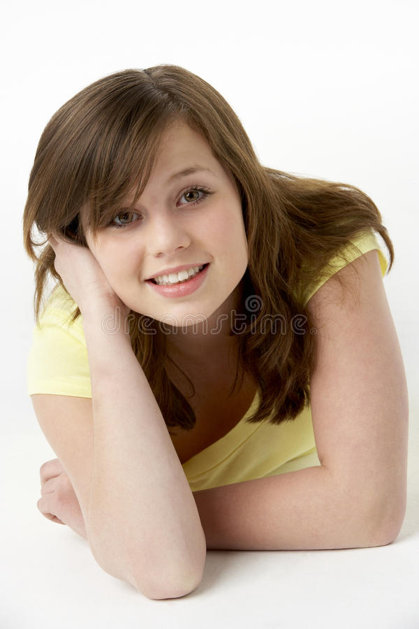 Young Girl Lying On Stomach In Studio stock photo
