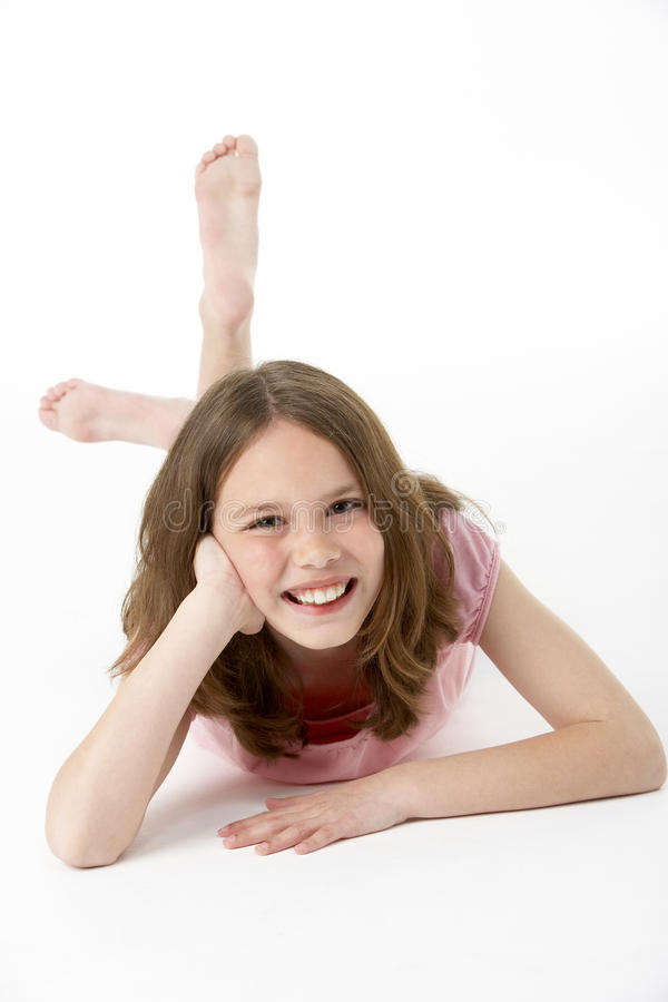 Young Girl Lying On Stomach In Studio stock photography