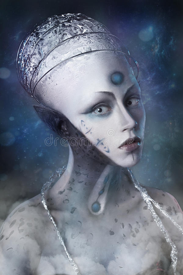 Young girl made up as an alien on the background of cosmic distances stock images