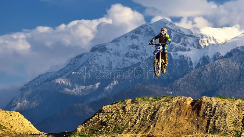 Young girl with motocross bike in Romania. Extreme sports stock images