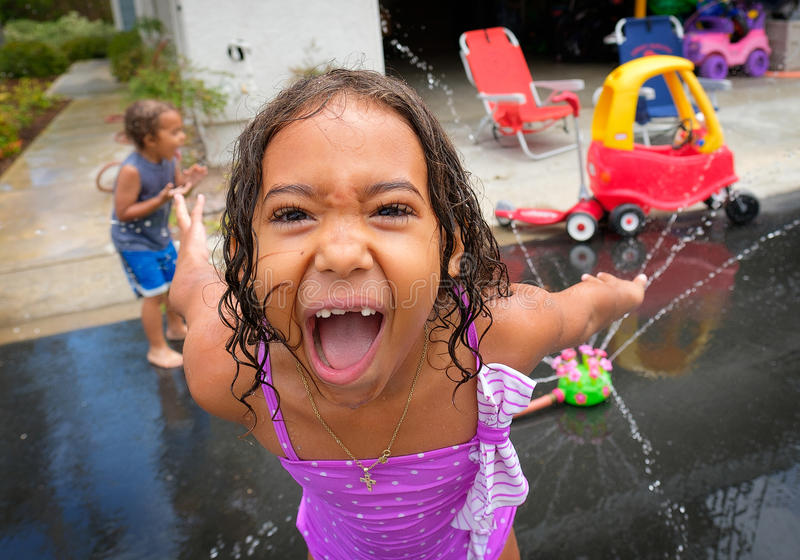 Young Girl Making Funny Face While Playing royalty free stock images